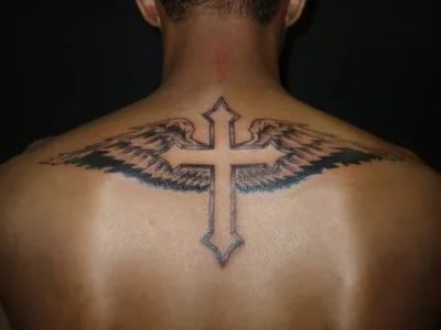 Что означает тату на спине в виде креста
